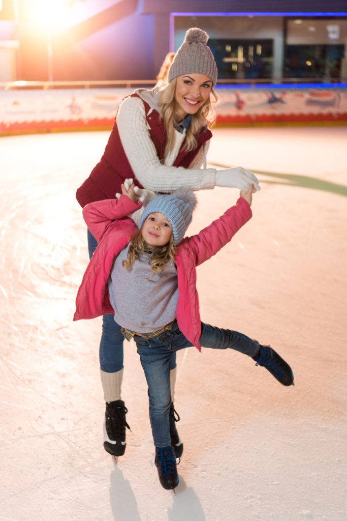 Mom and daughter skating during the Winter holidays